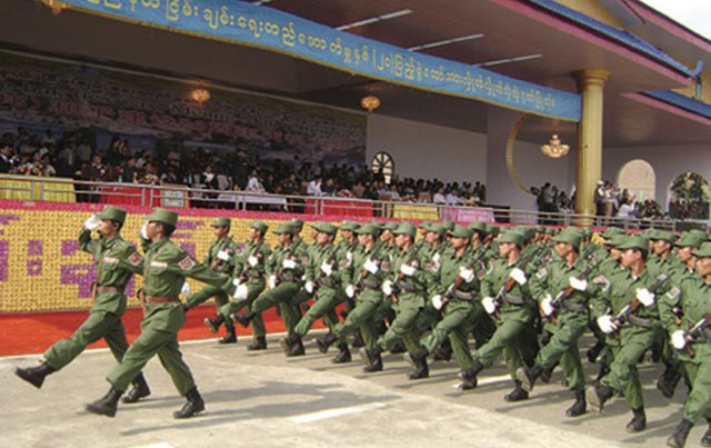 Photo by SHAN- the United Wa State Army (UWSA) soldiers march on the 20th anniversary in the Headquarters Pangsang in 2009.