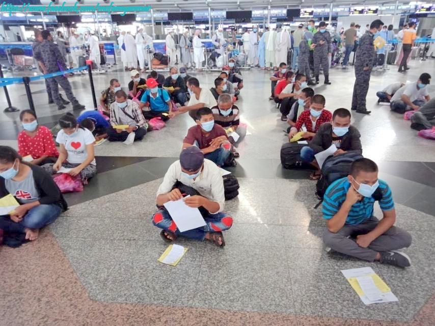 Photo Credit to MOFA Myanmar Myanmar migrant workers at Malaysia Airport