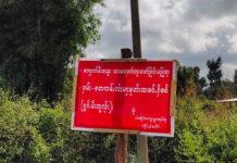 Lai Kha Hai Seng villagers against a coal mine