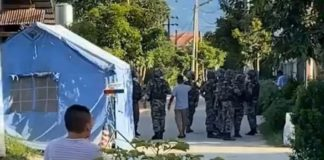 Chinese security police at Numkham China boarder